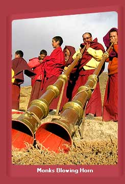 Buddhist Monks Blowing Horn